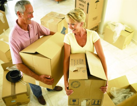 couple moving and holding cardboard boxes
